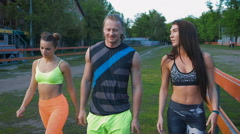 Sports people. The boy and two girls are after your workout fun and something to Stock Footage