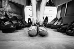 Woman holding ballet flats rather then high heels Stock Photos