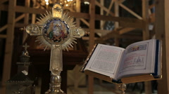 Holy Gospel Bible Book on a table in church - dolly shot - stock footage