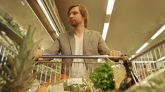 Handsome Man Shopping In A Supermarket, View From Shopping Trolley Stock Footage