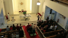 Catholic church interior in service day Stock Footage