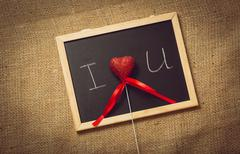 Toned photo of heart in declaration of love on blackboard Stock Photos