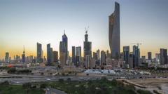 Skyline with Skyscrapers day to night timelapse in Kuwait City downtown - stock footage