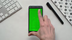 Android smartphone on white desk Stock Footage