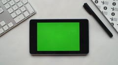 Android tablet on white desk Stock Footage