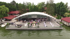 Aerial view over beautiful wedding ceremony venue reception on a lake - stock footage