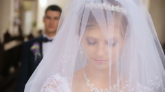 Groom lifts veil from face of bride Stock Footage