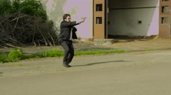 Two FBI agents aproaching a door of an abandoned building – Wide Shot - stock footage