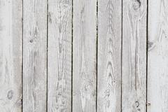 Painted old tacky grey wooden fence - stock photo