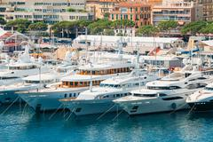 White Yachts Of Different Sizes Are Moored At City Pier, Jetty I Stock Photos