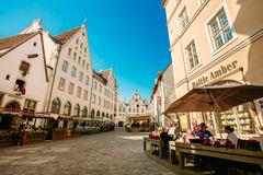 People resting In Street Cafe In Old Town Of Tallinn, Estonia - stock photo