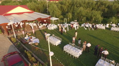 Aerial view over wedding ceremony party - outdoor English style Stock Footage