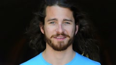 Young man portrait. Middle twenties. Long hair, and blue  eyes. - stock footage