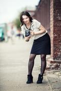 Girl with vintage camera - stock photo