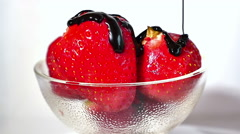 strawberries, drizzle of chocolate - stock footage