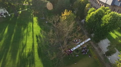 Wedding aerial. Outdoor drone shot of wedding decoration and guests at sunset. - stock footage