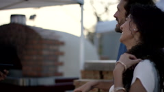 Couple discussing with chef at food stall. Stock Footage