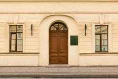 Door and windows on facade of office building Stock Photos