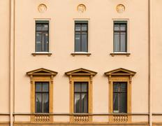 Windows in a row on facade of office building - stock photo