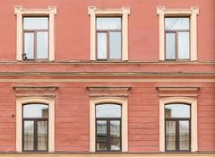 Windows in a row on facade of apartment building - stock photo