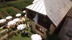 Aerial view of a house prepared for party with wedding dress on the balcony Stock Footage