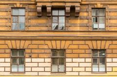 Windows in a row on facade of the Saint-Petersburg University of Economics Stock Photos