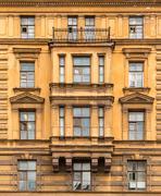 Windows in a row on facade of the Saint-Petersburg University of Economics Stock Photos