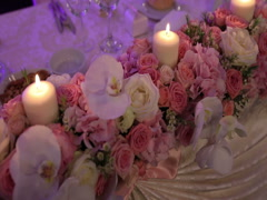 Wedding table decorated with flowers, decorative glass candles Stock Footage