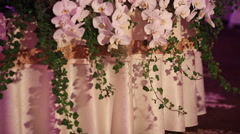 Wedding table decorated with flowers, decorative glass candles - stock footage