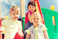 Group of happy kids on children playground Stock Photos