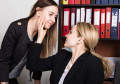 Sexual harassment. female boss sexually molested the female employee Stock Photos