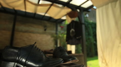 Groom black elegant shoes with the costume on background Stock Footage