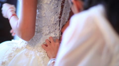 Bride making herself ready for wedding - stock footage