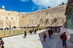 JERUSALEM, ISRAEL - FEBRUARY 17, 2013: People praying near Western Wall - stock photo