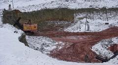 Excavator loads ore into dump-truck. Winter. - stock footage