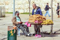 JERUSALEM, ISRAEL - FEBRUARY 20, 2013: Bread street vendor chatting with frie - stock photo