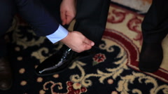 Stylish man in a fashion suit costume preparing to go out at a reception - stock footage