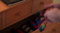 Man taking his colorful socks out from the closet - stock footage