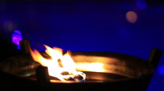 Flame firing in steel bowl Stock Footage