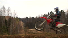 Motocross Training in nature. Jump on the platform Stock Footage
