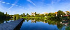 Pond in village with houses reflection in germany Stock Photos