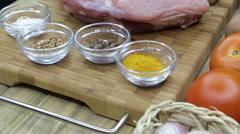Top view raw pork chop steak on wooden background. Stock Footage