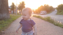 A little 1 year old baby boy is walking Stock Footage