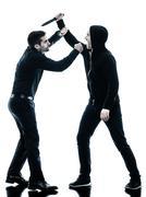 Men krav maga fighters fighting isolated Stock Photos