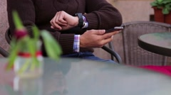 A man enters the PIN code on the payment terminal Stock Footage