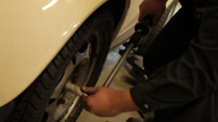 Mechanic changing a wheel Stock Footage