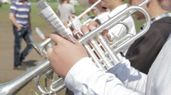 Brass instrument section of an orchestra performing outdoors - stock footage