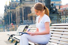 Woman tourist writes his impressions in a diary, Dresden, Germany Stock Photos
