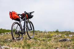 Bicycle with orange bags for travel Stock Photos