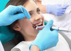 Treatment of tooth loss, the child to the dentist - stock photo
